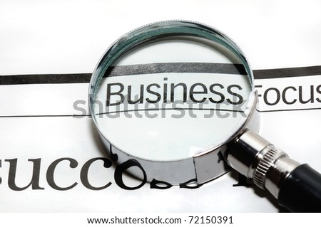 Magnifying glass and word business - business background