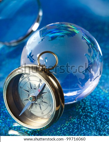 Magnifying glass, Compass and globe