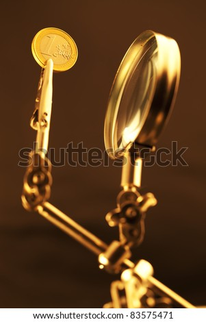 magnifying glass & 1 euro coin