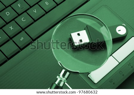 Magnifying glass focused on the removable flash drive
