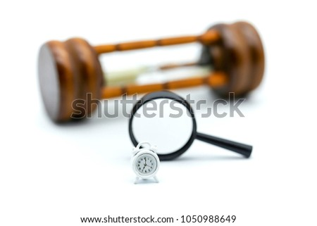 Magnifying glass focusing of Sandglass, hourglass with clock. #1050988649