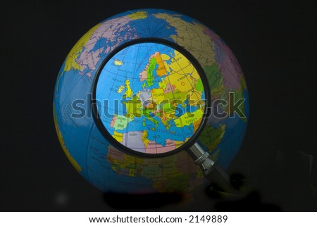 Magnifying glass focusing on Europe