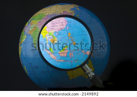 Magnifying glass focusing on South east Asia