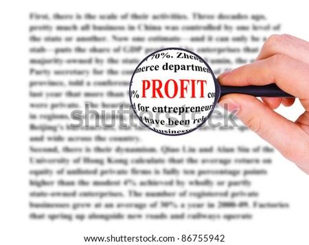 Magnifying glass in hand and word profit