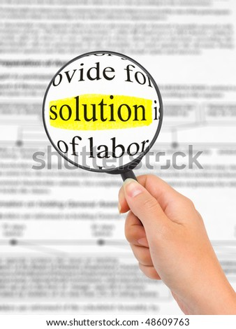 Magnifying glass in hand and word Solution - business background