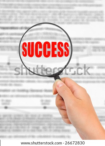 Magnifying glass in hand and word Success, business background