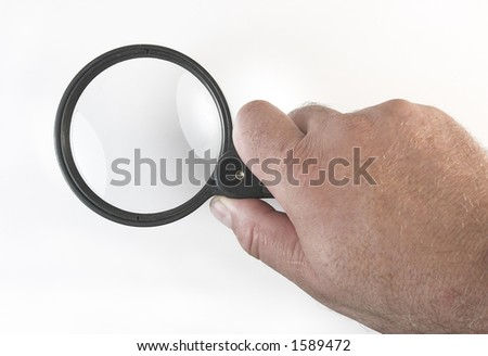 Magnifying glass in the hand