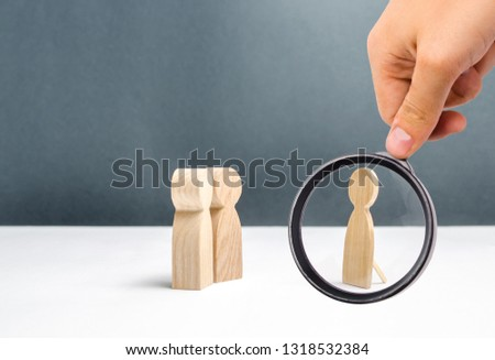 Magnifying glass is looking at the false human figure near two human figures looking at it. deception and mosheynik. There are no common interests and topics for communication. Unreal, unreal.