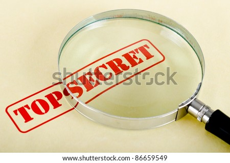 magnifying glass is on top secret inscription
