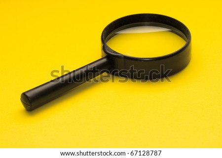 Magnifying glass isolated on the yellow background