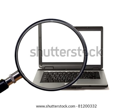 Magnifying glass magnifies laptop with white screen