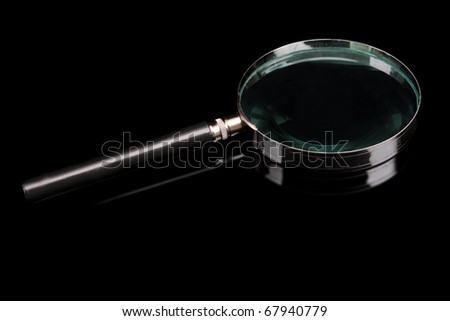 magnifying glass on a black background - stock photo