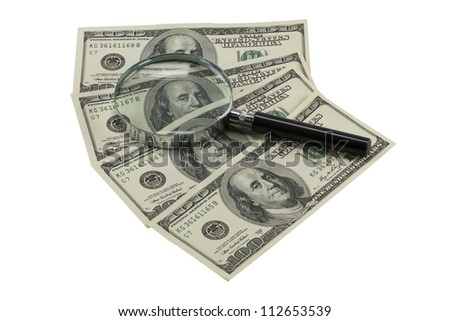 Magnifying glass on banknotes (with clipping path)