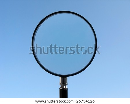 Magnifying Glass on blue background - stock photo