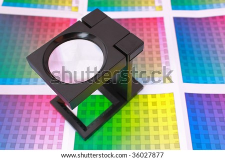 Magnifying glass on color swatch. Color Selection Pre-Press concept