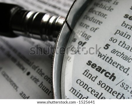stock photo : Magnifying glass on dictionary page with the word 'search'.