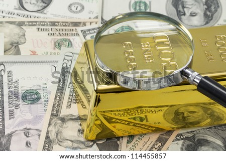 magnifying glass on gold with american dollars background