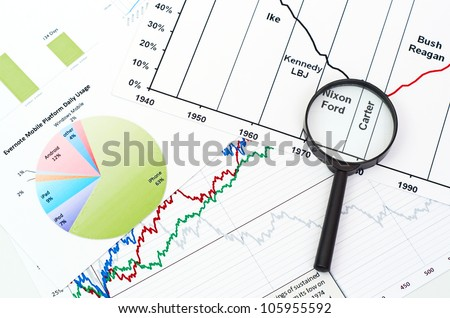 magnifying glass on graph business search background
