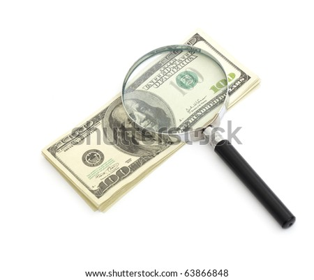 Magnifying glass on money background, business concept