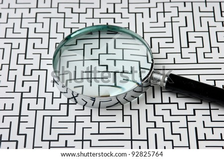 magnifying glass on the background of the labyrinth