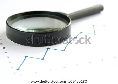 magnifying glass on the table and the schedule and place for your text
