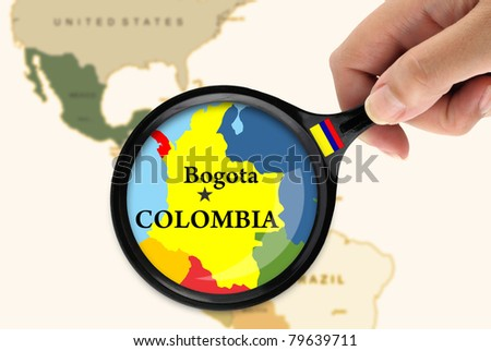 Magnifying glass over a map of Colombia