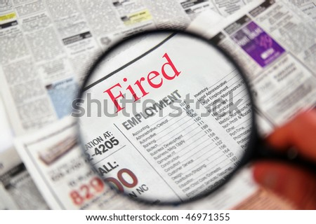 "Magnifying glass over a newspaper classified section with ""Fired"" text"