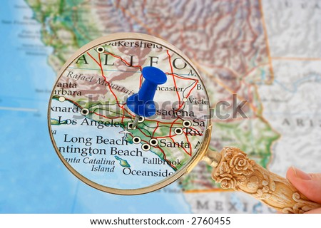 magnifying glass over Los Angeles, California map with destination tack