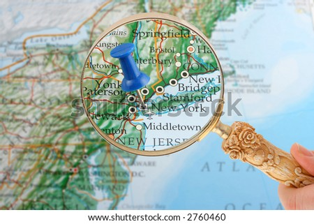 magnifying glass over New York, New York map with destination tack