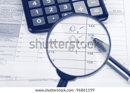 Magnifying glass over the tax form