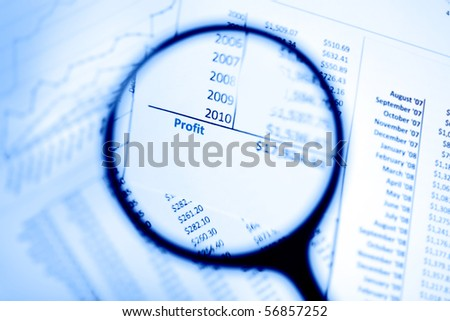 Magnifying glass showing profits