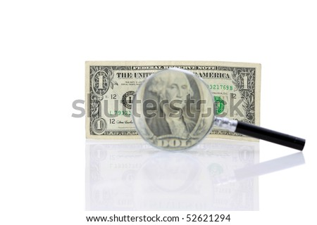 magnifying glass with a close up of a one dollar bill isolated on white