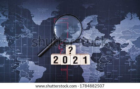 Magnifying glass with 2021 and question mark blocks. Cyber incident recovery planning concept, what is effective information technology disaster recovery due to business impact from coronavirus crisis Stock photo ©