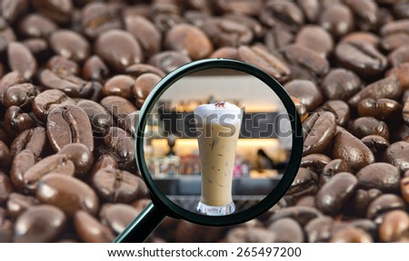 magnifying glass with background of roasted coffee beans to be ice coffee cup on store blurred background, food and drink with business concept