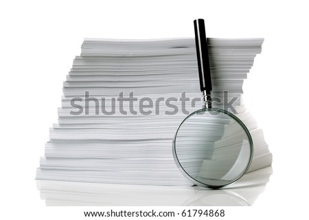Magnifying glass with stack of documents - concept for searching for a file