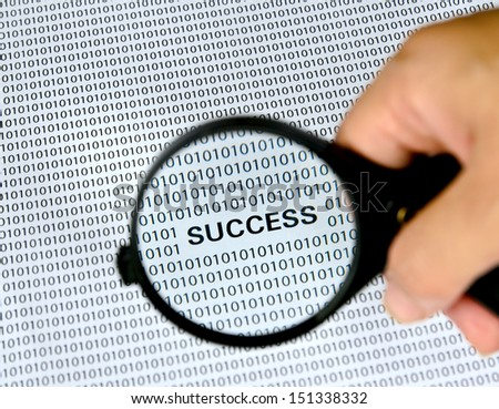Magnifying glass with success word on background .