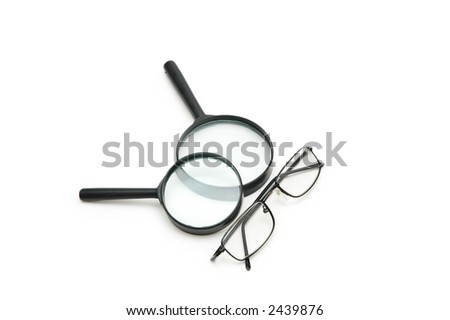 Magnifying glasses and reading glasses isolated on white