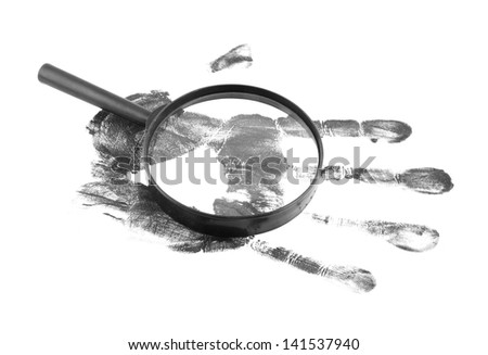 Magnifying lens and black hand print on white background