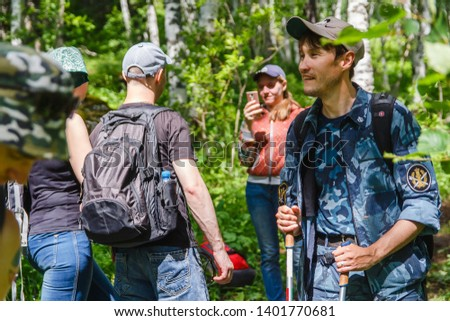 """Magnitogorsk, Russia - 02 July 2017 Hike in the mountains in summer """"Climbing the mountain of Shershiltau"""" #1401770681"""