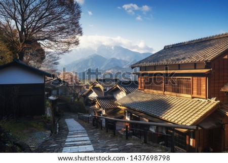 Magome juku post town of the Nakasendo with central alps mountain at sunrise, Kiso valley in  Nakatsugawa, Gifu Prefecture, Japan. Famous travel landmark of preserved  old Japanese town.