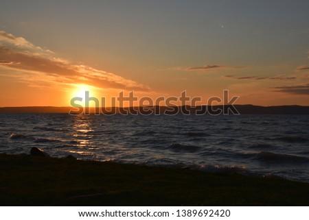 Magyarország,Siófok, Balaton parti naplemente, lángoló víz. Stock fotó ©