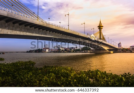 Maha Chesadabodindranusorn Bridge Suspension bridge across the chao phraya river in thailand. #646337392