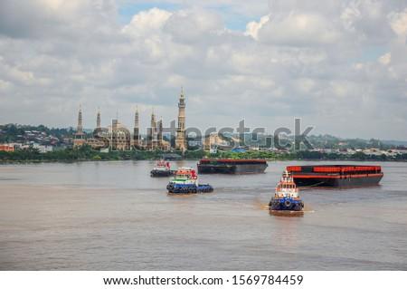 Mahakam river with Islamic mosque landmark as one of the iconic city of samarinda #1569784459