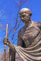 Mahatma Mohandas Gandhi Public Statue Front of Indian Embassy Embassy Row Massachusetts Ave Washington DC.  Gandhi is walking to sea on salt march.  Dedicated September 2000,  Artist Gautam Pal