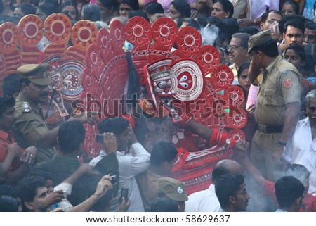 MAHE, INDIA - JANUARY 31 : Theyyam artists performing at the middle of the crowd at Palloor temple festival January 31, 2010 in Mahe, India.
