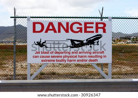 Maho Beach warning sign