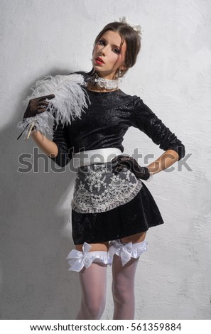 maid in uniform with a feather