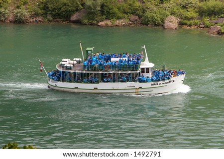 Maid of the Mist V  on the Niagara River travelling upriver towards Niagara Falls