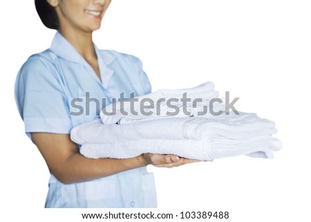 Maid woman holding towels. Shot at studio isolated on white background