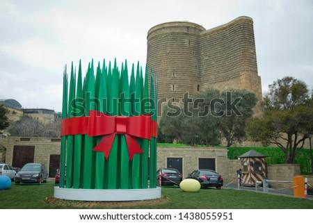 Maiden Tower (Baku). The Maiden Tower also known as Giz Galasi, located in the Old City in Baku, Azerbaijan. Artificial big Semeni. Novruz green fresh semeni.